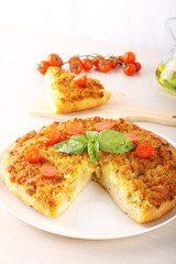 Pizza with breadcrumbs, onion and tomatoes