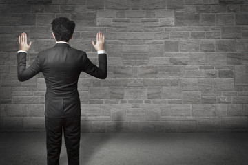 businessman hands up wall