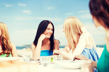 girls in cafe on the beach