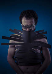 Bdsm, man covered with black strips, shibari concept art