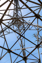 Upward view of the structure under power transmission tower
