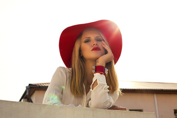 fashion photo ob beautiful model in shirt and red hat