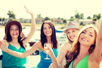 girls with champagne glasses on boat