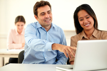 Attractive young couple working on laptop