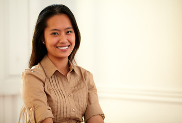 Young asiatic woman smiling at you