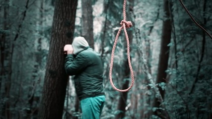 The noose before the man in the woods