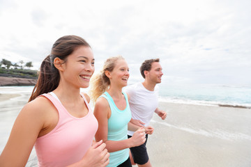 Group running on beach jogging