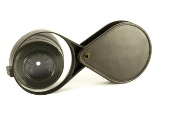 Lens with a magnifying glass