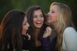 teens whispering secrets