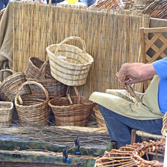 craftsman working to manufacture wicker basket