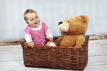 Little baby girl with teddy bear