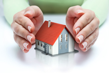 protect and insurance real estate concept  - home covered