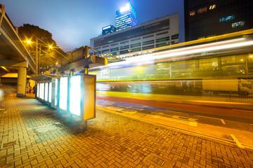 Blank billboard in city at night