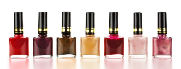 Row of varied red tone nail polish bottles