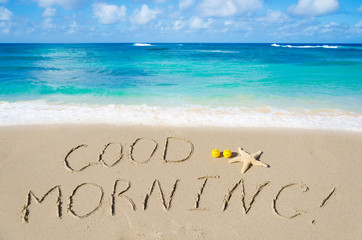 "Sign ""Good morning"" on the beach"