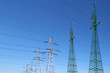 high voltage electric towers under blue sky