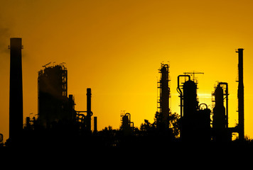 silhouette  of crude oil refinery station during sunset
