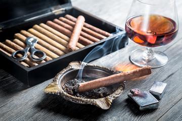 Aroma of cognac and cigar fuming