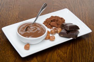 Composition of chocolate hazelnut spread, hazelnuts, chocolate a