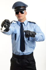 Young man in police uniform shows on you with nightstick