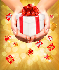 Holiday background with hands holding gift boxes. Vector.