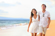 Couple walking on beach on romantic travel