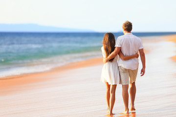 Beach couple walking on romantic travel