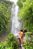 Fototapety Happy hiker - Hawaii tourists hiking by waterfall