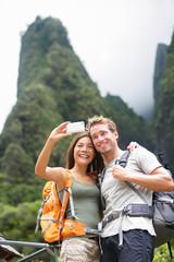 Couple taking selfie self portrait hiking, Hawaii