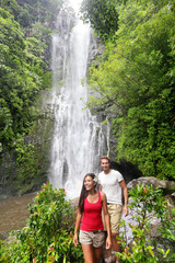 Hawaii tourists hiking by waterfall
