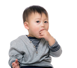 Little boy biting his finger