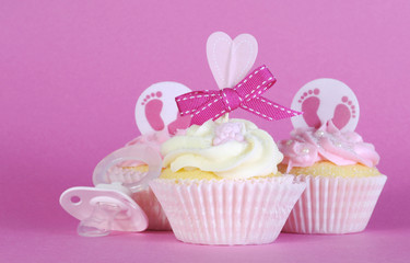 Pink theme baby girl three cupcakes with dummy pacifier