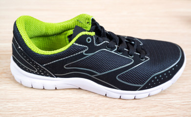 Black sneaker with green trim