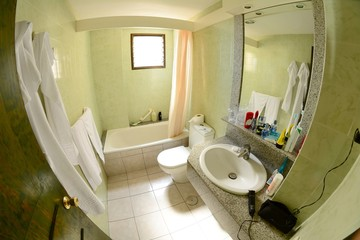 Hotel bathroom with appliance and cosmetic equipment.
