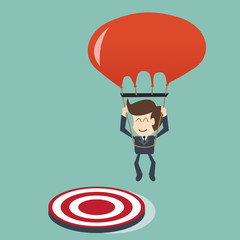 target concept - Businessman focused on a target with parachute