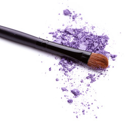 Purple eye shadow with brush isolated on white background