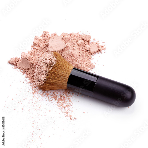 Face powder with brush over white background