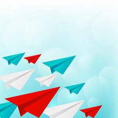 Paper airplanes on blue sky background