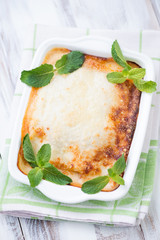 Vegetable lasagna with mint leaves, high angle view, studio shot