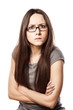 frowning woman with glasses