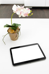 blank tablet on white table in the office