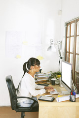 Young entrepreneur woman working on home office.