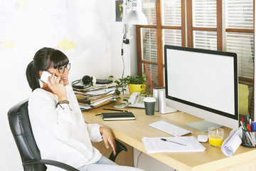 Young entrepreneur woman using cellphone on home office.