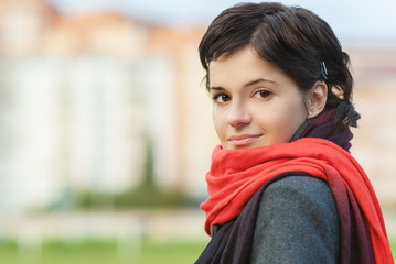 Beautiful girl with red scarf