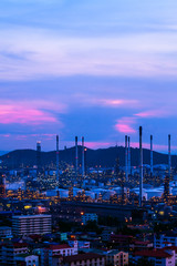 oil refinery against beautiful sunset