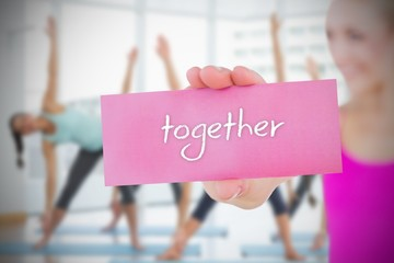 Fit blonde holding card saying together