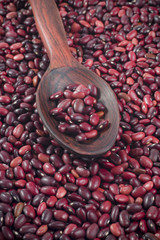 Simple red beans in polished wooden spoon