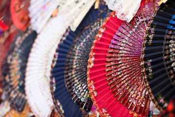 Colorful Spanish Fans arranged for sale in a store