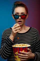 Beautiful girl watching movie with 3d glasses