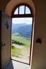 Open door with Alpine views